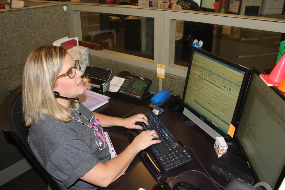 Woman Sitting Behind a Computer Working on Utility Services